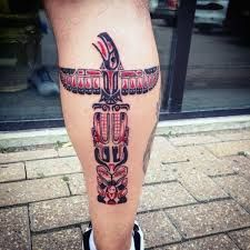 Man With Hieroglyphic Totem Pole Calf Tattoo Totem Pole Tattoo, Calf Tattoo, Tattoos With Meaning, Tattoo Designs Men, Cool Tattoos, Body Art, Carving, Ink, Totems