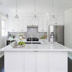 White Kitchen with Marble Arabesque Tile Backsplash