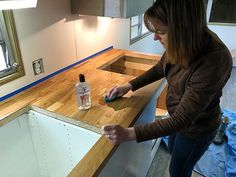 Sealing in that beautiful color with the first coat of food-grade mineral oil! After reading online about different ways to protect the butcher block, we settled upon the mineral oil route. Howard makes two products that we will be using: re