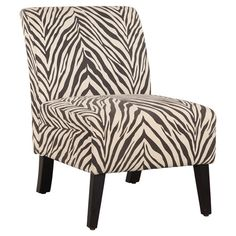 A chic slipper chair is a great way to add instant style to any space without taking up too much real estate. This zebra-print piece would look stylish besid...