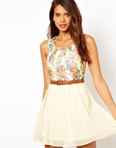 Imagen 1 de Vestido con diseño floral en contraste y cinturón de Rare