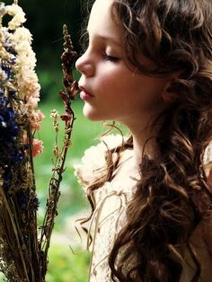 Beautiful little one taking time to smell the flowersღ~*~*✿⊱╮