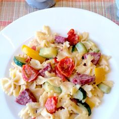 Summer Sausage Farfalle Recipe Main Dishes with cherry tomatoes, onions, yellow bell pepper, zucchini, summer sausage, garlic, extra-virgin olive oil, salt, pepper, italian seasoning, chicken broth, grated parmesan cheese, cream, flour, black pepper, bow-tie pasta