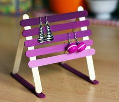 DIY earring holder made out of popsicle sticks