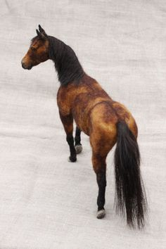 Custom needle felted pose-able sculpture of your horse made by Noelle Stiles.This felt was made with the deceased horses hair in the mane and tail.If