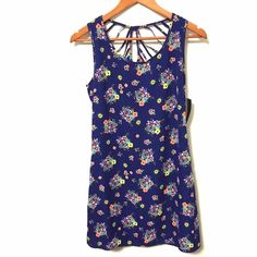 "Want and Need Spring Floral Shift Dress This body skimming shift dress makes a cheerful statement with bright bunches of flowers on a field of blue. Perfect for spring and summer. The back features a cage strap detail. Closes with a button at the back of the neck. Fully lined, NWT, 100% polyester, machine washable.  Bust ~ 36""  Waist ~ 33"" Hip ~ 37"" Length ~ 33.5""  If you have any questions or would like additional pics/measurements I'd be delighted to help  No PP, please make offers with…"