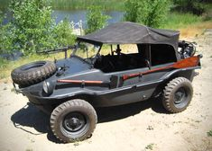 1943 Volkswagen Schwimmwagen - to see is to want. You just know that a vehicle that floats, has a propeller, paddle and attached axe is gunna be a lot of fun.