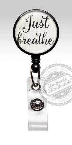 "Cute badge reel with the inspirational quote of ""Just Breathe"" in black letters over a white wooden background. The perfect badge for an OB GYN nurse. ID Badge reels are ideal for Medical staff, Nurses, Doctors, Teachers, Students, Government and Transportation workers who are required to wear identification. I say...why not look stylish while wearing one! Badge reels are available in: clear, black, and white. The stethoscope tags are available in frost and black. The lanyard and carabiner…"