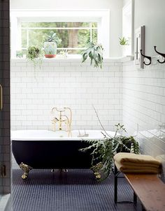 I love the idea of filling up a bathroom with floral decor! The freestanding tub is also always a nice touch to any bathroom.