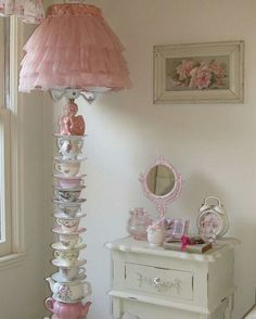 The Lamp SHADE ---  Ruffles would be easy re-do for damaged shades.