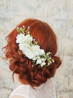 White hair flowers in pretty red hair. #bridal #hair Much like the prom hair I did up for someone last year, love the style as an updo that meets the ...