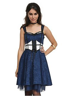 <p>A timeless dress from the world of <i>Doctor Who</i>. Corset-style top with sweetheart neckline, lace-up detail and public call box verbiage and graphics, allover Gallifreyen symbol jacquard, and tulle underlay.</p><ul>	<li>97% cotton; 3% spandex</li>	<li>Dry clean only</li>	<li>Imported</li></ul>