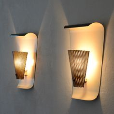 Pair of Jacques Biny Appliques   From a unique collection of antique and modern wall lights and sconces at https://www.1stdibs.com/furniture/lighting/sconces-wall-lights/