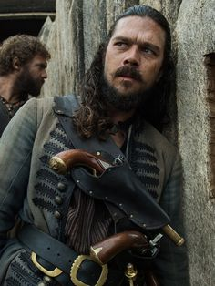 Silver and Billy Talk Post-Murder Attempt on 'Black Sails' Season 4 Episode 5 - Luke Arnold as Long John Silver and Tom Hopper as Billy Bones in 'Black Sails' Season 4 episode 6 | Inverse