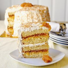 Pina Colada Cake - oven roasted pineapple jam is the star of the show with coconut and marshmallow frosting.