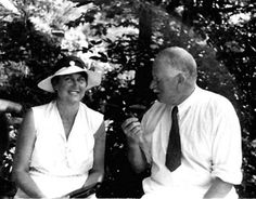 Emma and Carl Jung are seen in this 1933 photograph sitting on the wall just outside of the lecture hall overlooking the lake.