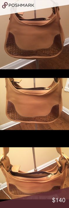 """Tanners creek leather designs hobo hand bag purse Tanners creek leather designs hobo hand bag purse. 8"""" long 12"""" width. 12"""" adjustable strap drop. One inside zip pocket. Two outer back pockets. Tan with brown embossed leather trim. New. Tanners Creek Bags Hobos"""