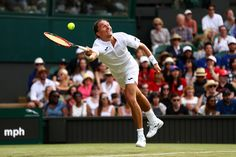 Alexandr Dolgopolov Photos Photos - Alexandr Dolgopolov of Ukraine plays a forehand during the Gentlemen's Singles first round match against Roger Federer of Switzerland on day two of the Wimbledon Lawn Tennis Championships at the All England Lawn Tennis and Croquet Club on July 4, 2017 in London, England. - Day Two: The Championships - Wimbledon 2017