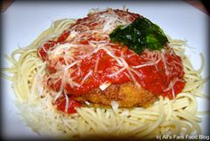 Chicken Parmigiana - Lightly breaded chicken breast with marinara sauce topped with melted mozzarella over spaghetti. - $17.99 Tonys Town Square Restaurant, Chicken Parmigiana, Breaded Chicken, Disney Food, Magic Kingdom, Spaghetti, Marinara Sauce, Mozzarella