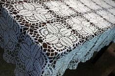 This beautiful tablecloth is made from white cotton thread #10 . This square tablecloth will add touch of beauty to any table. It will make beautiful and unique wedding gift , house warming gift or just as special gift to someone special.  Size is 57x67  Thank you for looking.   ✿.。.:* ☆:**:. ✿.。.:* ☆:**:.✿.。.: ☆*.:。.✿  http://doilymania.etsy.com   ✿.。.:* ☆:**:. ✿.。.:* ☆:**:.✿.。.: ☆*.:。.✿