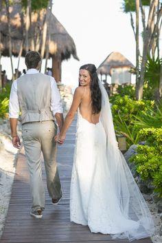 Wear a sexy backless beach wedding dress in Mexico!  (Wedding Photography by Fun In The Sun Weddings)  https://funinthesunweddings.com/wedding-stories/melissa-brian-riviera-maya-wedding-valentin-imperial-maya-resort/