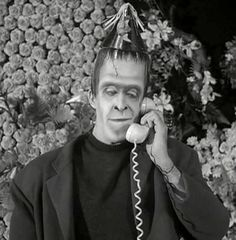 herman calling home from the funeral parlor Munsters Tv Show, The Munsters, Los Addams, 1313 Mockingbird Lane, Herman Munster, Black Sheep Of The Family, Yvonne De Carlo, Female Vampire, Six Feet Under