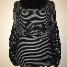 Free People Top Pre-owned black and white top with lace inset on each side. Makes this a very comfortable and cute top. Free People Tops