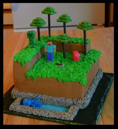 "Three 10"" cakes stacked. Bricks and trees made from homemade..."