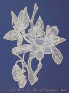 Honiton (East Devon) lace sprig - Here is a very hungry caterpillar represented in East Devon lace. A sprig of apple blossom and leaves are worked in whole stitch and half stitch. Ribbed and rolled work add a three-dimensional effect. The caterpillar is worked with a twisted vein through its body and head, and purls to give the impression of legs. The lace is designed to make it look as though the greedy caterpillar is munching its way along the stem. Needle Lace, Bobbin Lace, Very Hungry Caterpillar, Lace Flowers, Three Dimensional, Devon, Layers, Lily, Museum