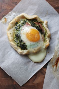Flaky Pie Crust topped with Spinach, Sauteed Onion, Feta, Black Forest Ham, and a Baked Egg