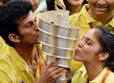 Saina Nehwal kisses the 2013 IBL Trophy.