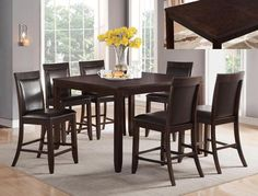 "Ariana Espresso   Counter Height  Table and 4 Chairs  $789.00     Table  54"" x 36~54"" x 36"" H  (With 18"" Leaf)     Extra Chairs $99.00 with Espresso Bonded Leather Seats.  21.3"" x 20.5"" x 42"" H  C/M 2768-ESP"