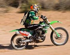 Dirt bike rider wearing Veskimo Hydration Backpack & cooling vest in desert race
