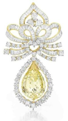 Yellow Briolette-cut Diamond Brooch in white and yellow gold.  Diamond Is A Girl Best Friend