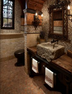 Rustic old world charm stone bathroom
