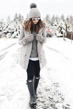 Casual outfit, snow outfit, snow day outfit, winter outfit, winter layers, rain day outfit, comfy outfit, skiing trip outfit, cold weather outfit, cozy outfit, monochromatic outfit, all grey outfit. - grey pom pom beanie, grey hooded coat, mirror aviator sunglasses, grey sweater, white shirt, black leggings, grey knit gloves, black rain boots