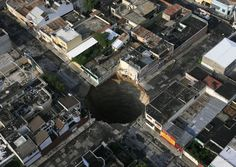 30 story deep sinkhole caused by rains of the Tropical Storm Agatha in Guatemala City