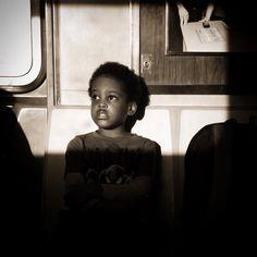 Spider-Man #sepia #urban #urbanart #train #subway #sunset #city #citylife #nyc #light #shadow #bw #blackandwhite #contrast #cinematography #spiderman #children #boy #ride #newyork #nyc #ny #iphone #portrait #frame  #photooftheday
