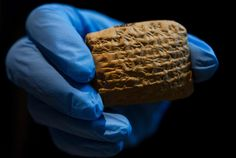 """What the Heck is Cuneiform, Anyway? The writing system is 6,000 years old, but its influence is still felt today. Cuneiform, was invented some 6,000 years ago in what is now southern Iraq, and it was most often written on iPhone-sized clay tablets a few inches square and an inch high. Cuneiform means """"wedge-shaped,"""" a term the Greeks used to describe the look of the signs. http://www.smithsonianmag.com/history/what-heck-cuneiform-anyway-180956999/#s168FyHpjuPCeAsO.99"""