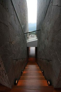 """I love the mystery of this """"tunnel"""" or """"gate"""" into the unknown. Beautiful combination of glass, wood and concrete."""