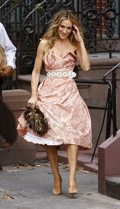 Sarah Jessica Parker - Vivienne Westwood Dress, Manolo Blahnik Heels, and Salvatore Ferragamo Pheasant Feather Bag
