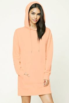 A knit sweatshirt dress featuring a hood with contrast drawstrings, ribbed trim, French terry cloth lining, a kangaroo pocket, and long sleeves.