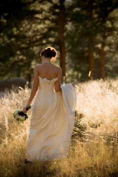 Golden Hour, field, mountains, bride, strapless dress, peaceful. Weddings at Della Terra Mountain Chateau in Estes Park, Colorado.