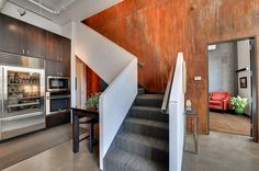 Because of its special weather resistance, Corten steel mainly in the outdoor area is used. Discover the many applications of Corten steel inside today and Staircase Wall Decor, Modern Staircase, Staircase Design, Stairwell Wall, Textured Carpet, Patterned Carpet, Painted Staircases, Stair Well, Stairs