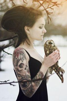 skull tattoo on girl's arm