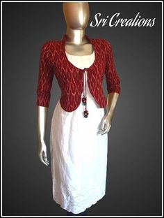 The off white Hakkoba top worn with maroon Ikat coat with a quirky hanging to jazz it all up...