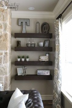DIY Living Room Floating Shelves via Shanty-2-Chic