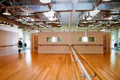 Fitness Studio. Ballet bars, bamboo floors, pendant lights. Barre Fitness North Shore