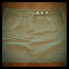 """J.Crew polka dot chino skirt Army green with tiny white polka dots. Three white button  and tab detail with zipper fly. Side hip pockets. One back pocket. 100% cotton. Waist 35"""" Length 16"""" J. Crew Skirts"""