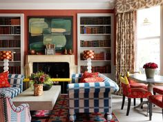 Knightsbridge Hotel | Colourful patterns live happily together in this library designed by Kit Kemp | Rust-orange, blue and white, red.
